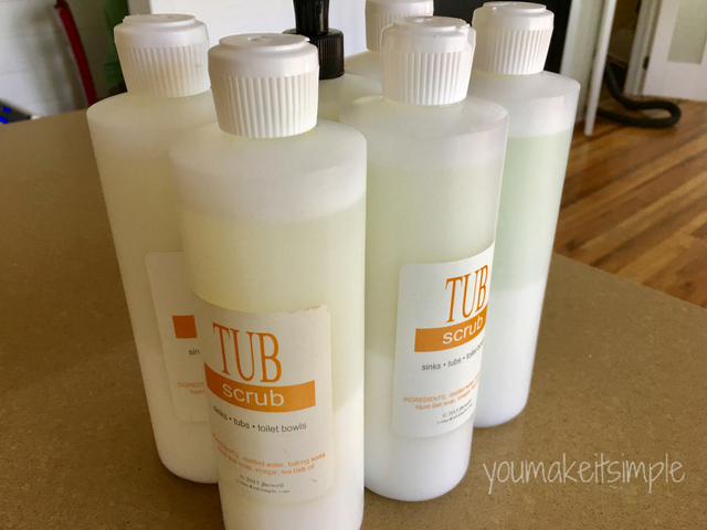 natural bathroom cleaner filled bottles