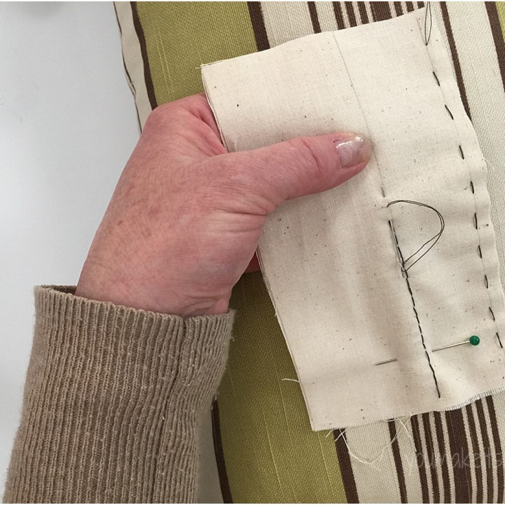 sewing by hand pillow prop