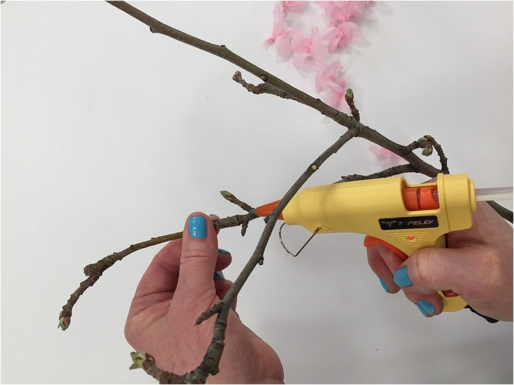 tissue paper blossoms gluing to branch