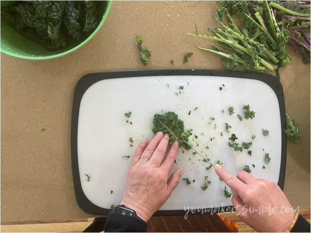 cutting out spine of kale